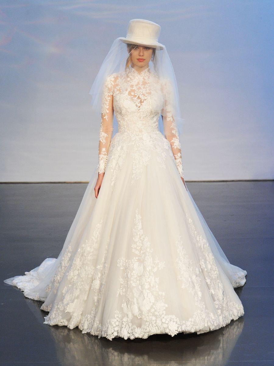بالصور فساتين افراح , الريش والفيونكات احدث صيحات الموضة في عالم فساتين الزفاف 476 13