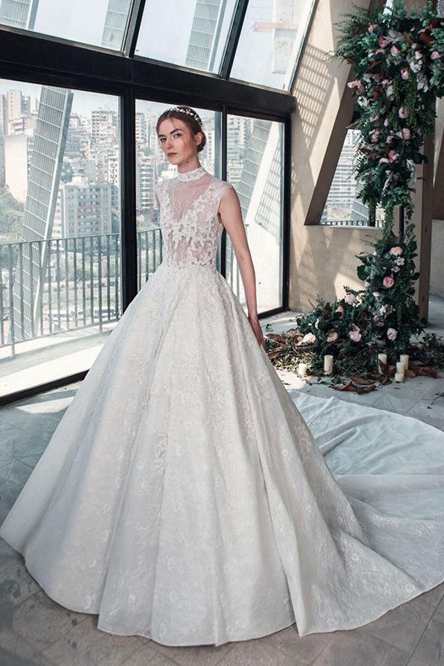 بالصور فساتين افراح , الريش والفيونكات احدث صيحات الموضة في عالم فساتين الزفاف 476 6