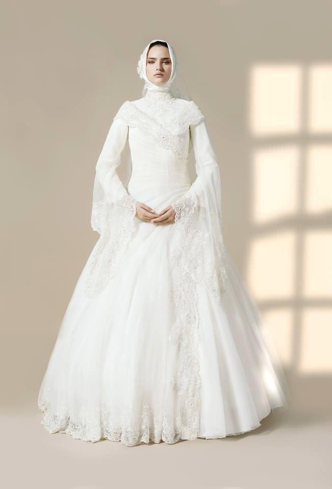 بالصور فساتين افراح , الريش والفيونكات احدث صيحات الموضة في عالم فساتين الزفاف 476